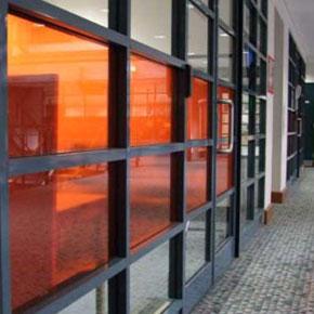 Orange tinted glass doors and walls